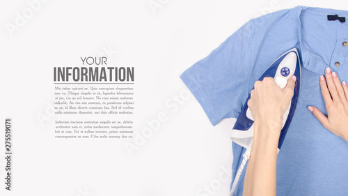 Fotografie, Obraz Blue iron in hand blue shirt on ironing board top view, household, sample text o