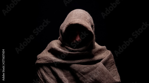 Obraz na plátně Poor man in rough robe looking down with humility, early christian prophet