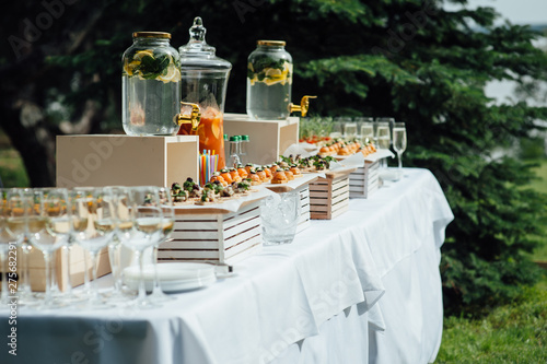Fotografie, Tablou catering services background with snacks on guests table outdoor wedding party