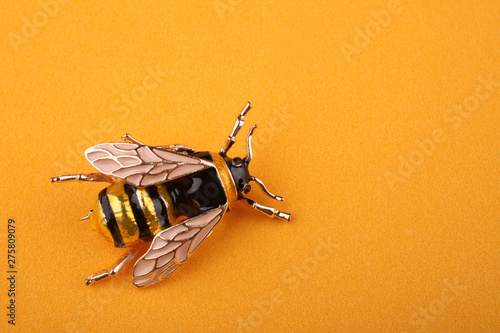 Tableau sur Toile Beautiful brooch in the form of a fly on a yellow background