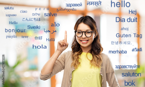 Photo translation, education and people concept - happy asian woman in glasses or stud