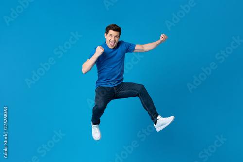 Fototapeta American man jumping and enyoying his success