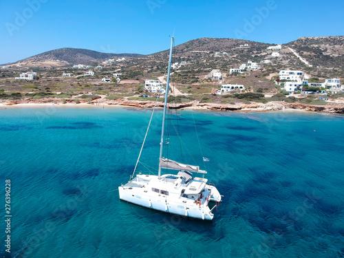 Canvas Catamaran sailing in  blue, turquoise water in Greece, beautiful catamaran next