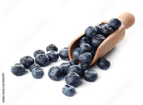 Slika na platnu Ripe blueberry and scoop on white background