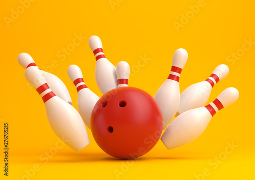 Fotografia Red Bowling Ball and scattered white skittles isolated on yellow background