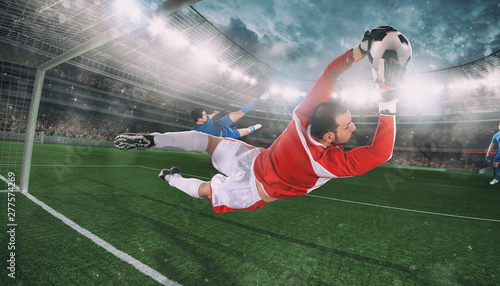Foto Goalkeeper catches the ball in the stadium during a football game