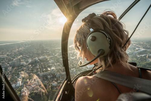 Fotografie, Obraz Portrait of beautiful blonde women enjoying helicopter flight