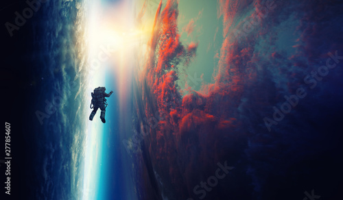 Canvas Print Spaceman and planet, human in space concept