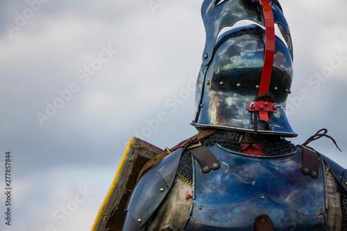 Obraz na płótnie A brave medieval knight wering a helmet