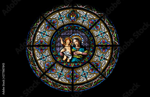 Fotografia, Obraz Virgin Mary with baby Jesus, stained glass window in the Cathedral of Saint Lawr