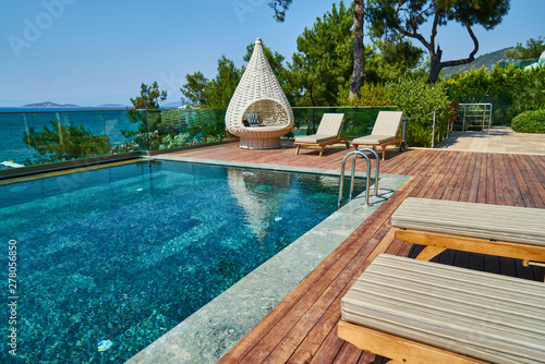Obraz na plátně Luxury hotel pool and relaxing landscape