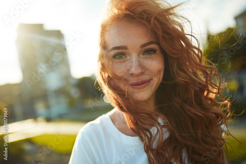 Portraits of a charming red-haired girl with a cute face Fototapeta