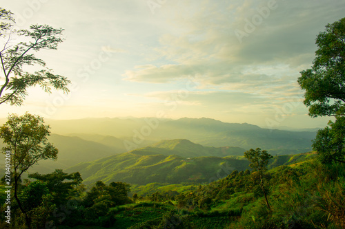 Fototapeta The longitudinal mountains and the setting sun and the forest on Doi Tung