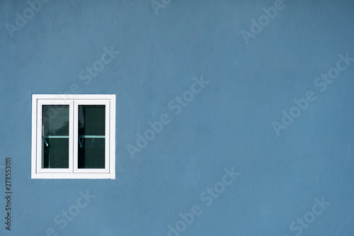 white window on grey blue wall home architecture background