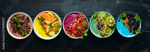 Canvas Print A great set of colored fruit smoothies with yogurt, fresh fruit and berries