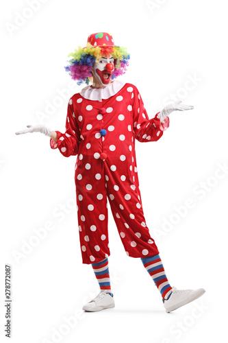 Vászonkép Cheerful clown standing and posing