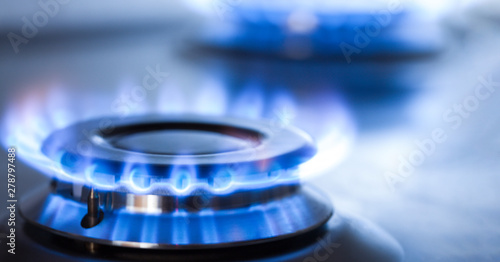Fotografija kitchen gas cooker with burning fire propane gas