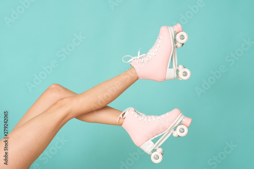 Fotografie, Obraz Pink roller skates on the legs. Activity can be fun!