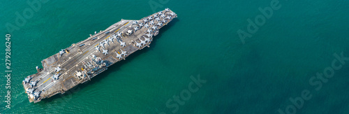 Fototapeta Aerial view American navy nuclear aircraft carrier view from above, Military army navy ship carrier airplane full loading fighter jet aircraft, Copy space