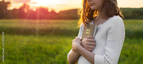 Stampa su Tela Christian teenage girl holds bible in her hands