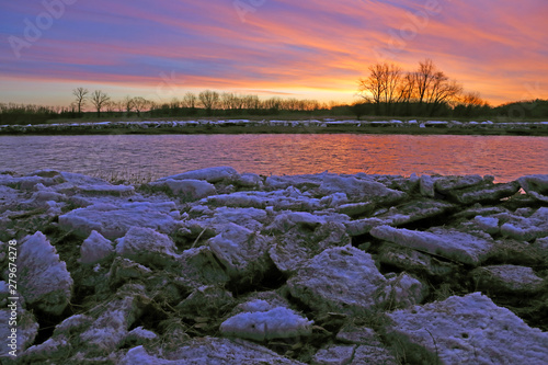 Canvas Print The Grand River at sunrise with ice chunks on the banks