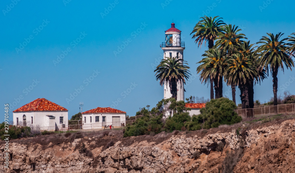 he Point Vicente Lighthouse is at the top of a cliff along the rocky Pacific Coast of California in Rancho Palos Verdes, north of the Los Angeles Harbor.