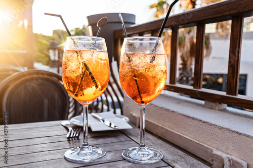 Canvas Print Two wine glass of cold cocktail Aperol spritz on background of restaurant