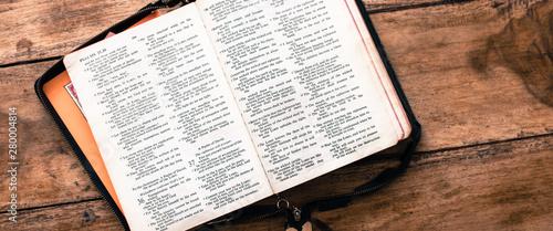 Fotografie, Tablou Holy Bible isolated on old vintage wooden table