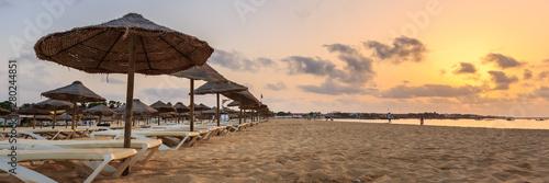Tableau sur Toile Beach sunbeds and umbrellas