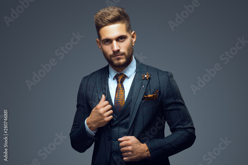 Canvas-taulu Stylish young man in suit and tie