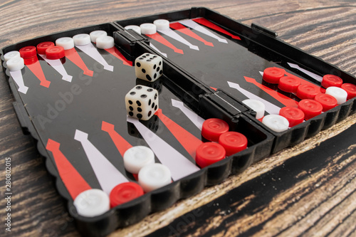 Tableau sur Toile Small pocket backgammon on a wooden table