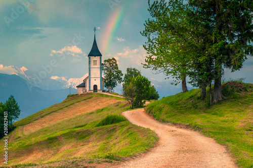 Valokuvatapetti Idyllic rainbow landscape with Saint Primoz church, near Jamnik, Slovenia