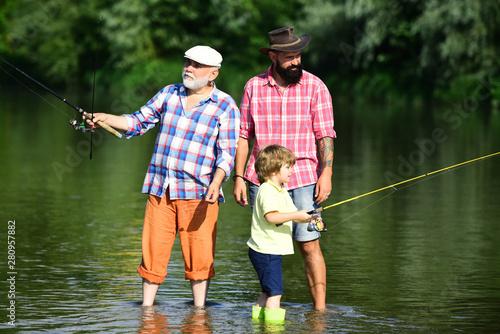 Fotografia Family fishermen fishing with spinning reel