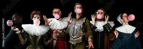 Fényképezés Young people as a medieval grandee on dark studio background