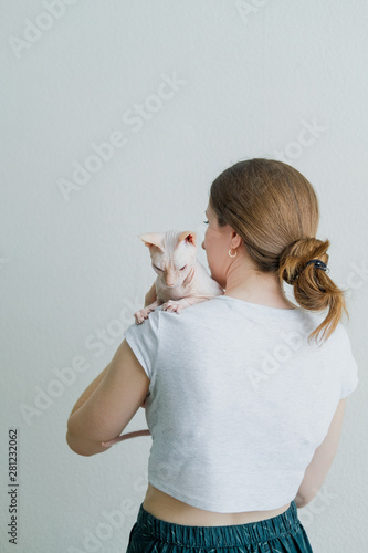 Naked girls holding cats Woman Holding Hairless Cat Don Sphynx Breed With Pink Naked Skin On Her Shoulder Stock Photo Adobe Stock