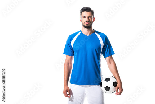 Fotografia soccer player holding ball and looking at camera Isolated On White