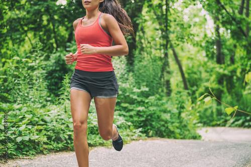 Canvas Print Woman runner on city run marathon race running jogging outdoors in summer active sport lifestyle