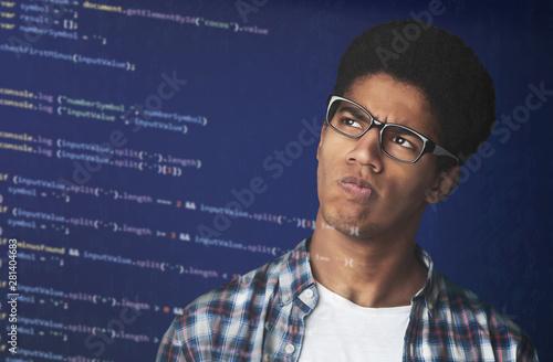 Obraz na plátně Thoughtful Afro Guy in glasses Looking at strange code
