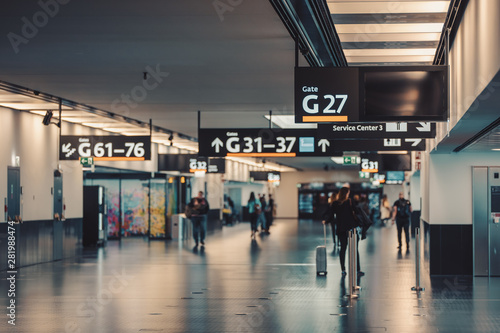 Fotografie, Obraz Peoples walking and carries luggage in Vienna airport terminal