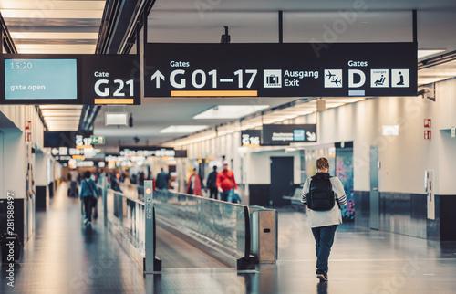 Peoples walking and carries luggage in Vienna airport terminal Fototapeta
