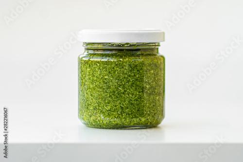 glass jar of pesto Fototapeta