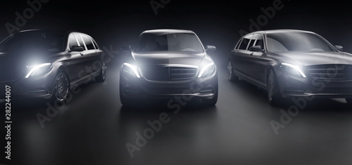 Fotografia Luxurious cars, limousines in garage with lights turned on.