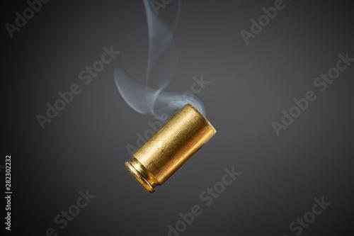 Fotografie, Obraz smoking bullet casing tumbling