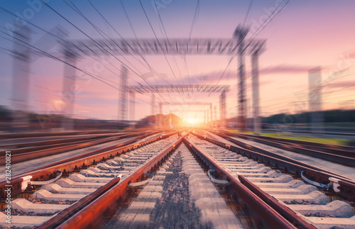 Canvas Print Railroad and pink sky with motion blur effect at sunset