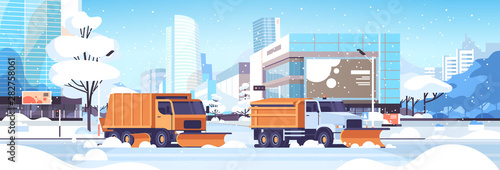 Photo snow plow trucks cleaning road urban downtown street with skyscrapers business b