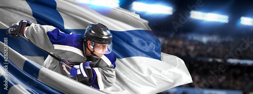 Canvas Print Finland Hockey Player in action around national flags