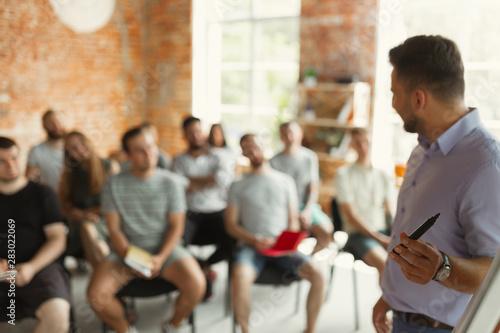Obraz na płótnie Male speaker giving presentation at university workshop