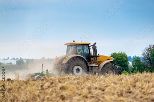 Photo Tractor cultivating the field