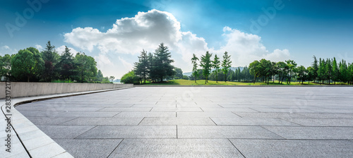 Empty square floor and green woods natural scenery in city park