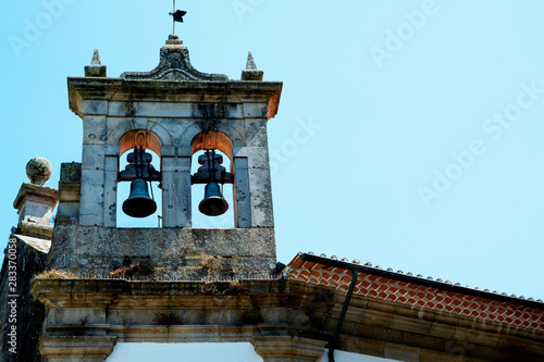 Belfry in the form of an open wall with two bells Fototapeta